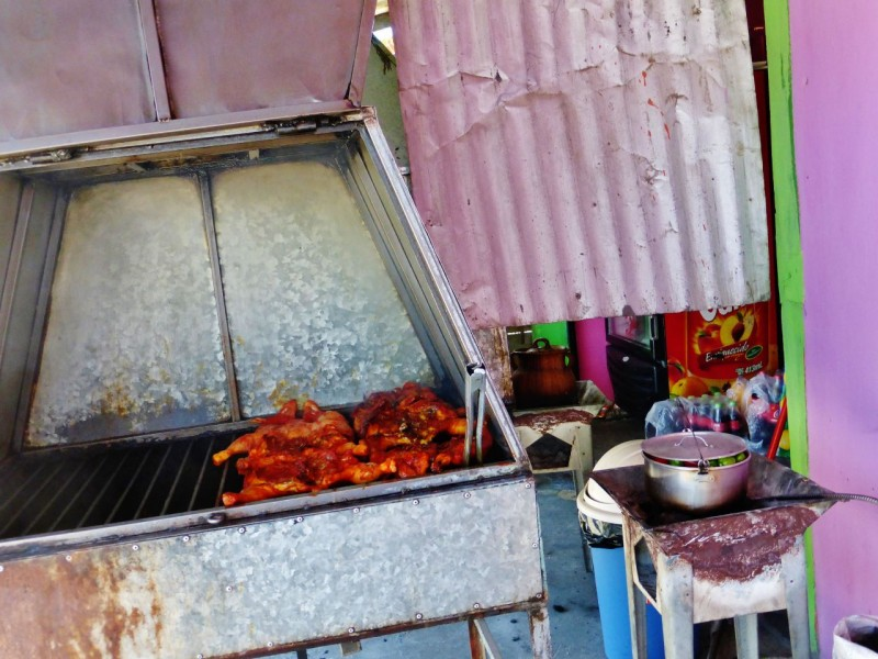 Mexican fast food consists of roadside taco stands and pollo asado (roasted chicken) stands.  Lunch time found us driving through Ocosingo on a red road heading north toward the Mayan ruins of Palenque.