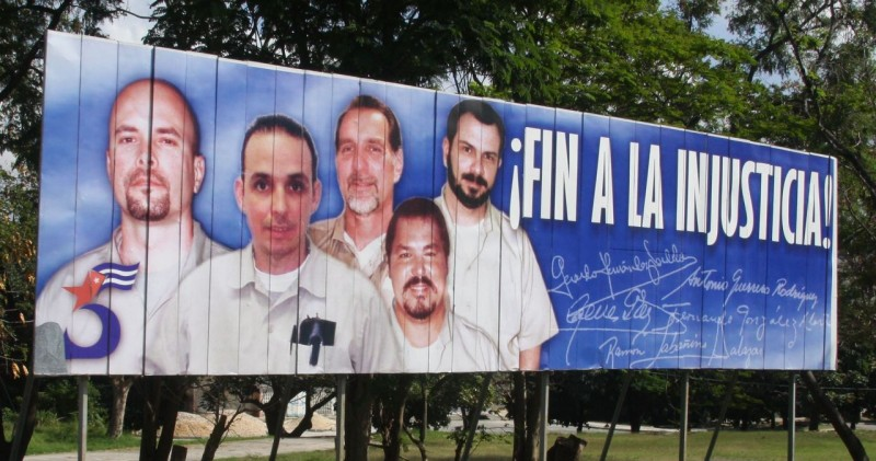"""End the Injustice!""  This huge billboard was along the highway coming from the airport. Our taxi driver tried to explain to us what it meant, but in the Spanish/English translation we didn't get the whole story. Evidently these five Cubans are being held by the U.S. government for something (?) while Cuba is holding a CIA agent who was caught trying to establish Internet service in the country. Both governments are at a stalemate over the issue.  The same taxi driver described Fidel as ""Loco"" and his brother Raul as ""Stupido.""   ""End the Injustice!""  This huge billboard was along the highway coming from the airport. Our taxi driver tried to explain to us what it meant, but in the Spanish/English translation we didn't get the whole story. Evidently these five Cubans are being held by the U.S. government for something (?) while Cuba is holding a CIA agent who was caught trying to establish Internet service in the country. Both governments are at a stalemate over the issue.  The same taxi driver described Fidel as ""Loco"" and his brother Raul as ""Stupido."""