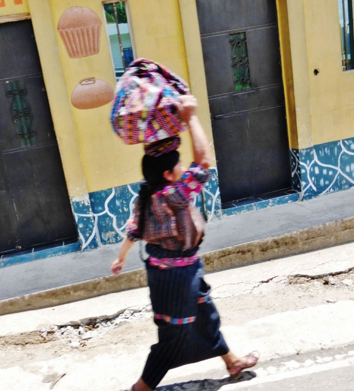 Over the last 3 months of travel, we have seen many women carrying a myriad of things on their head.  The ones that are able, pride themselves on balancing heavy loads without using their hands.  I missed the photo shot, but saw one woman carrying a full sized cooler without holding on!