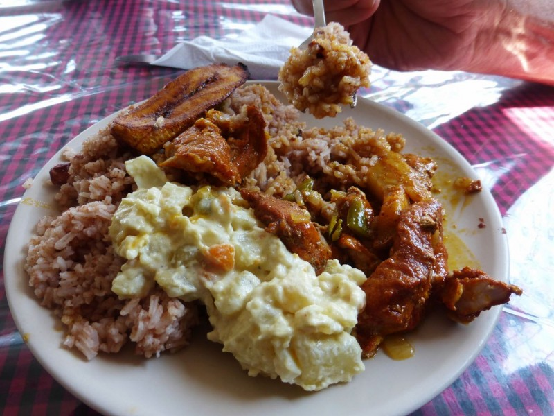 Typical Belizean street food. Stewed pork and chicken, rice and beans, potato salad and a fried plantain on the side. Yummmm.