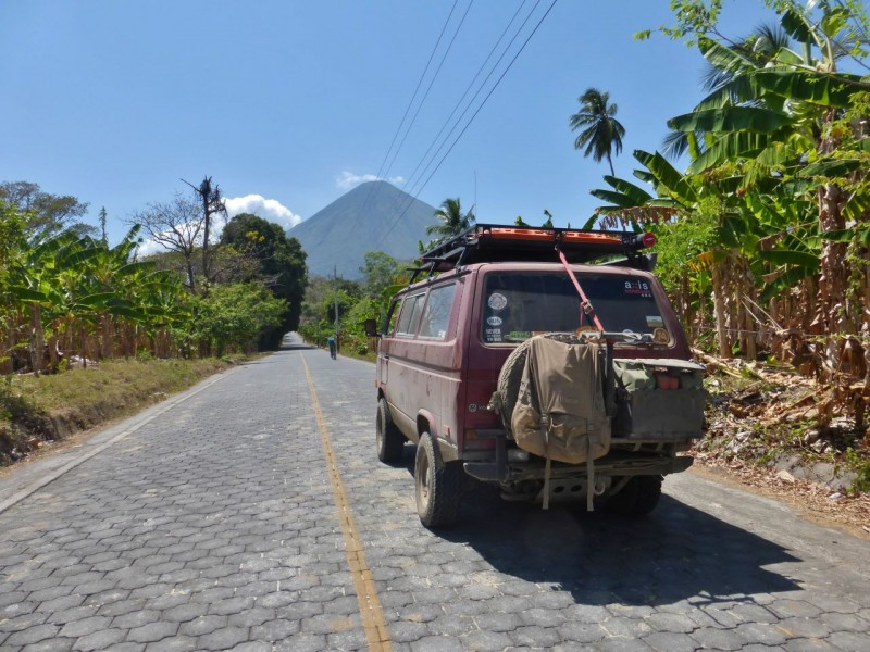 How would you like to lay all those pavers to make this road?  Wonder how long it took them?  Volcán Concepción in the distance is the volcano that forms the northwestern part of the island.  It is live and that is a little plume coming from its top, not a cloud.