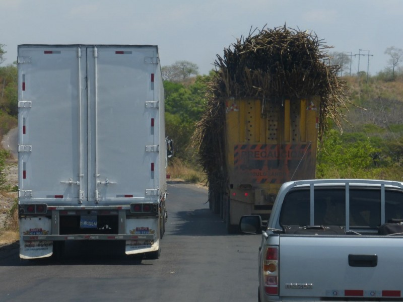 An interesting study in the contrast between trucks while driving through Honduras… and wondering how to get around them!