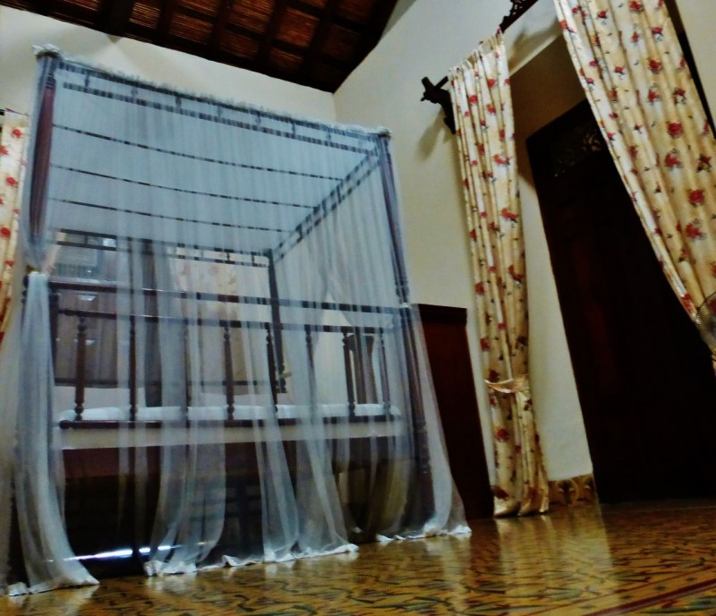 Our room was huge with this enormous canopy bed complete with mosquito netting.