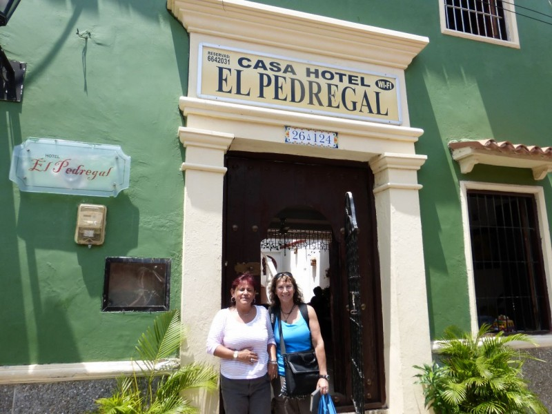 "We had found an inexpensive, but cute hotel on the internet near the ""Walled City"" in the old part of town. The taxi ride from the airport was short, and when we pulled into the ancient, tiny streets of the neighborhood we were delighted!  Hotel Pedregal turned out to be wonderful.  The owner, Patricia, was warm and welcoming, assuring us that this was our home while we were in Cartagena. Our room was charming, featuring a colonial style vaulted ceiling and windows (sans glass) with wooden shutters, which looked out on the street below where cheerful locals hung out, enjoying their Saturday."