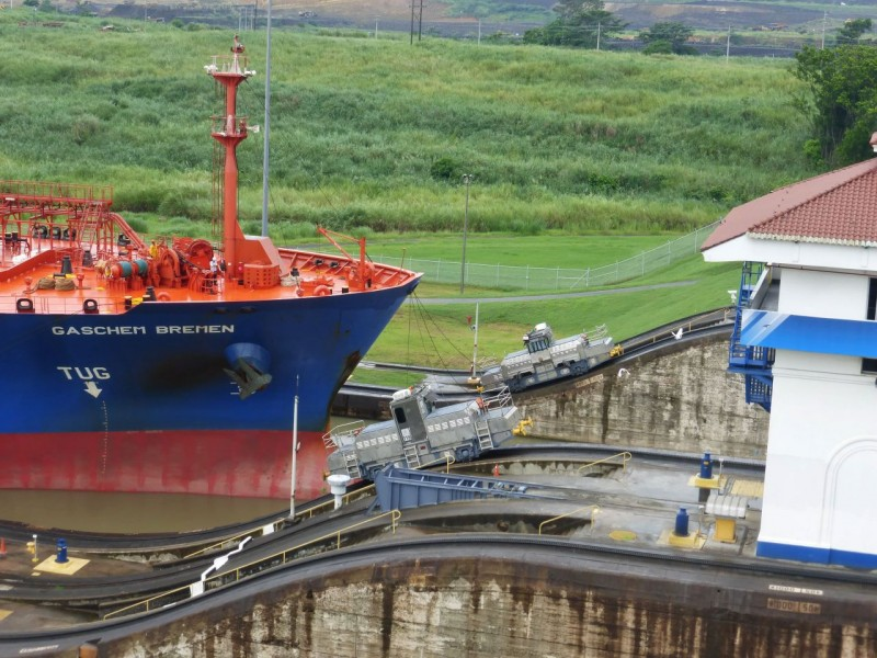 Next these powerful electric tugs on both sides of the lock hook on to the ship and pull it ahead into the next lock.  Not only must they pull the boat, but they must also climb the 45% grade of their tracks to reach the height of the next lock.