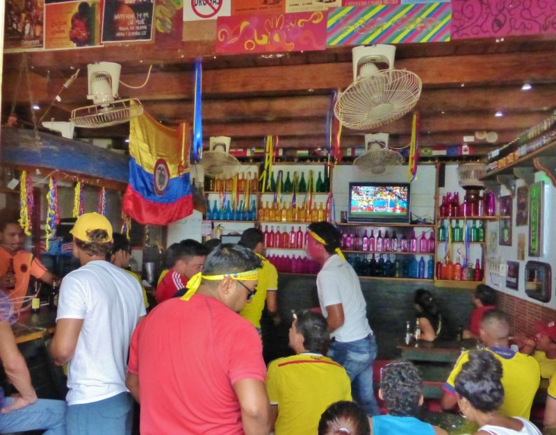 "We rushed back to our little village…Colombia was just starting another World Cup fútbol game, and we joined the locals in this bar to cheer on ""our"" team.  Ned had even bought a yellow jersey so we didn't stick out too much."