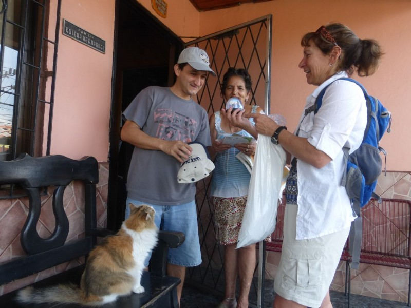 We brought some little gifts for the family. Wilson wears his new Lake Tahoe baseball cap while Kat explains a Lake Tahoe snow globe to him, his Mom, Marta and the family cat. Unfortunately, his Dad, Jesus was away that day.