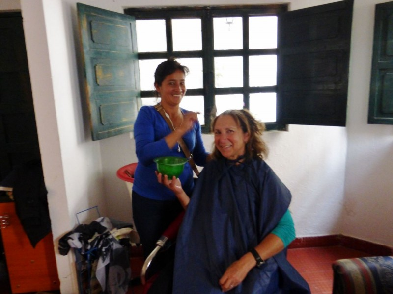 "Kat's priority one in the big city was getting her hair done.  I'll let her tell it… ""Back in the small pueblo of Villa de Leyva, it seemed like a simple thing to get a little color touch up.  Asking around, I found that ""Celia's"" was touted as the finest salon in the village.  Unfortunately, Celia's was crowded with curious, gossiping locals and was a tiny, run-down house.  Celia herself was busy, so her daughter, Diane, did my color…kind of… First I had to wait 45 minutes past my appointment time. Then I had to wait while Diane ran to another store to buy the color that would supposedly match mine.  When we finally got going, I had to hold the bowl of goop while Diane applied it, the water in the (bathroom) sink was ice headache cold as she rinsed it out, and to top it off, the color did not take.  In fact, my hair was in danger of being slightly on the orange side of gray-brown.  I was on the verge of tears, when Celia told me to come back in the morning to have it re-done.  I politely declined, offering a few bucks to cover the cost of the color.  This job would have to wait for the more cosmopolitan city of Bogota!"
