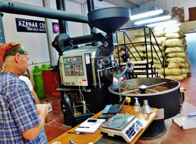 Watching the company's brand new, state-of-the-art CNC roaster at work.  Note all the scales and vials sitting around.  Looks more like a drug lab.  Well this IS Colombia after all.