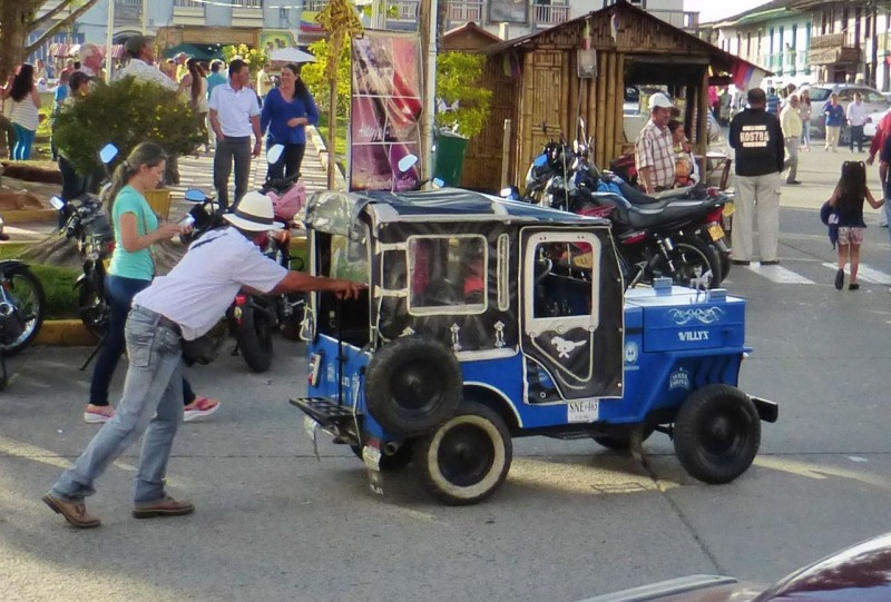 "More Jeeps.  This time in ½ scale and human powered.  Kids seemed to have a blast ""driving"" these beauties around the square, pushed by their owners for a few pesos."