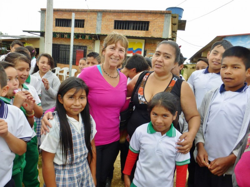 The school's reception to us was overwhelming.  All the teachers, the principal, and most of the student body, crowded around and begged us to enter their classrooms and explain the importance of learning English.  Here Kat poses with Tatiana and Darli and the teacher responsible for their English.