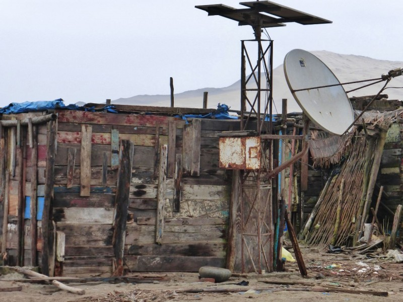 The ever present satellite dish, on one of the not-so-permanent structures in town.