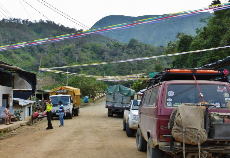 "La Balsa was the sleepiest, quietest border crossing ever.  We were the only vehicle crossing into Peru and it appeared there hadn't been another in quite a while. The Peruvian guard was so slow on his computer that we jumped in and filled out some of the forms for him!  He also appeared colorblind as he never did figure out Charlotte's color but asked us what it was repeatedly.  By the time he was finished it was dark, so we asked him if we could camp on the ""lawn"" in front of the border hut.  No problem!  The whole experience was such a switch from our usual border experiences where we have crossed fingers for no trip halting red tape, and can't wait to get as far away from the area as quickly as possible. We spent a peaceful night, except for around 4am when we were awakened by the sound of horrible, native singing accompanied by top volume, Peruvian rap music. (For lack of a better description) We both peaked out, expecting to see some kid in a car parked with his stereo blaring.  Instead, in the single yellow street light, we viewed two guys and a donkey ambling down the street. The donkey had a boom box strapped to its back.  Welcome to Peru."