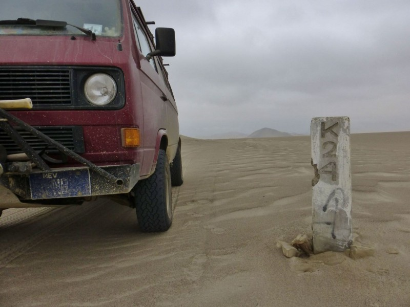 These km markers became our guides.  We would get to one, then scan the horizon for the next, spot it and then head for it.  All morning we found our way through endless sand dunes this way.   For me, it was the absolute highlight 50 miles of the 18,000+ miles we have covered so far.   Unfortunately, poor Kat continued to suffer and was not enjoying it half as much as I was.  A pity because it is her favorite landscape too.