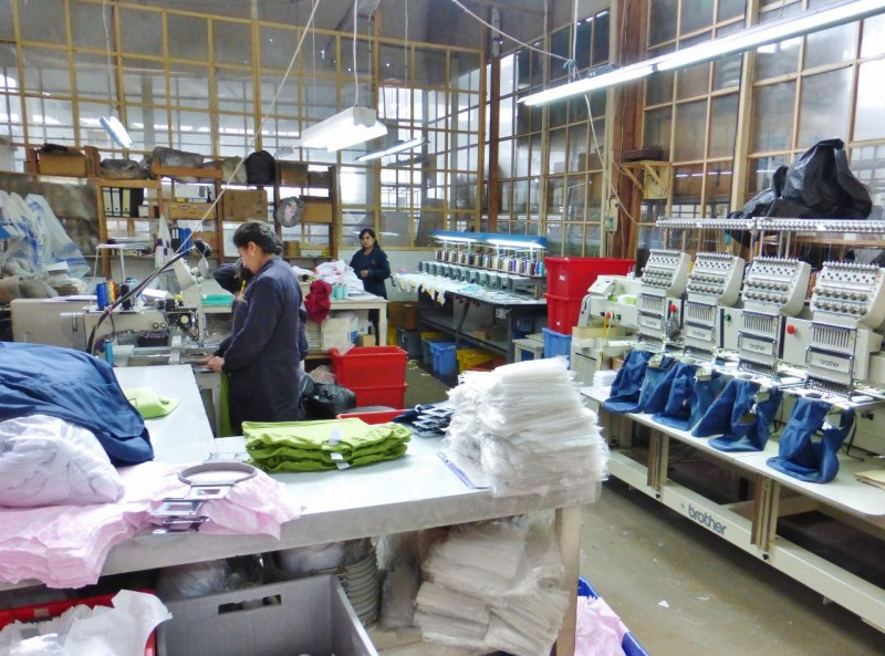 The factory specializes in children's school uniforms and doing embroidering of garments for other, larger factories in the area.  There seemed to be a lot of manual, tedious work going on. Hans explained that the gals who work here make US$342 per month and that's a high wage!