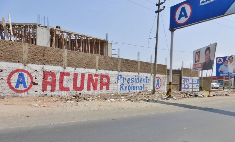 "Another common scene was these huge political campaign ""posters"" hand painted everywhere. Wonder if Acuña, if he gets elected, will do something about all the trash in front of his sign."