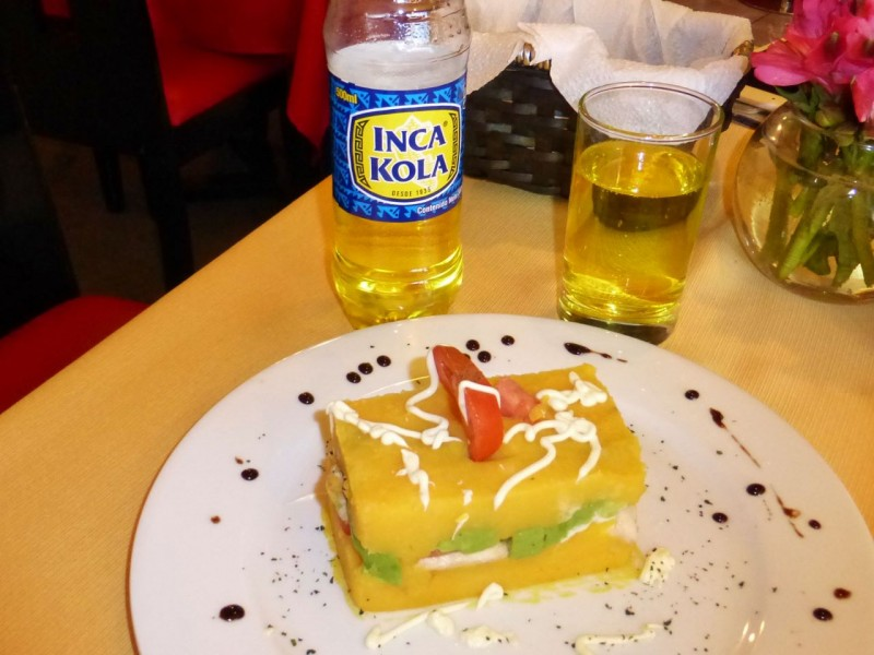 "An interesting ""sandwich"" I had one day.  The yellow was cold mashed potato with chicken, avocado and tomato sandwiched inside, different and pretty good.  Inka Cola, a Peruvian standard since 1939, made with real coca leaves."