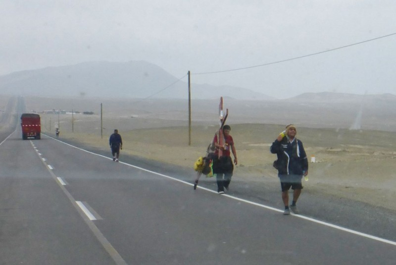 Along the Pan Am heading toward Lima we passed dozens of religious pilgrims walking north. Some were hauling huge crosses with a wheel affixed to their end to ease in dragging them along.