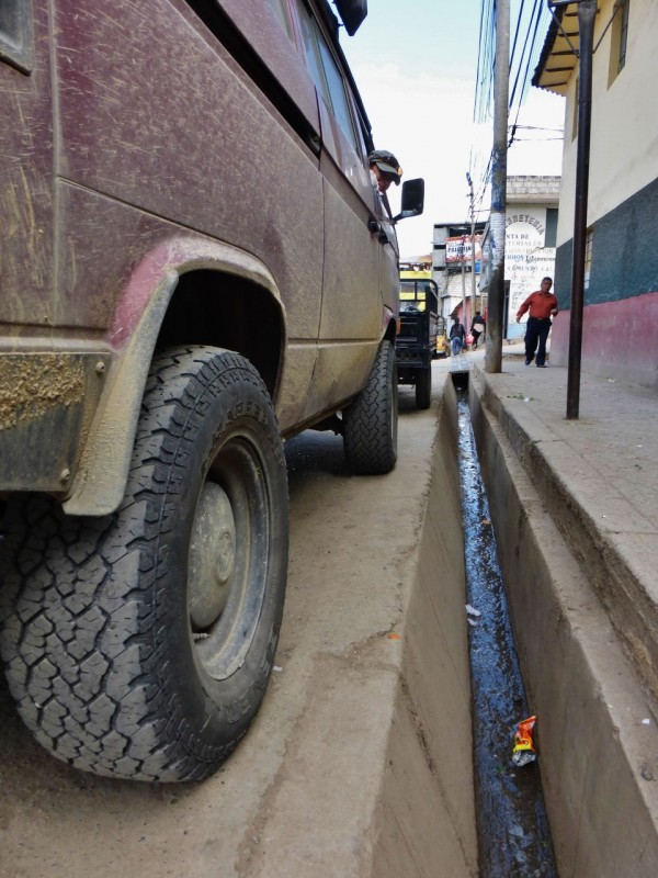 We remembered these crazy curbs from 2008, too.  Puts a whole new perspective on getting parallel parking just right. After Abancay it was just a few more hours to Cusco but everything went to hell. My fever went on a tear, making driving these windy roads a chore.  Kat was passed out on the bed in back, practically comatose when Charlotte decided to get into the act and shredded all her belts on a particularly nasty cliffhanging stretch of roadway.  To get to the engine the bed needs to be pulled up so there went Kat's rest.  Upon tearing into it I found the alternator mount cracked – again.  Fu**ing Volkswagen design.  The alternator and its mounting brackets have been the mechanical bane of the whole trip.  All the mounts and the alternator were new in La Paz, Baja after our debacle with the welder alternator.  Since then Charlotte in general has been a mechanical rock.   The charging system has worked flawlessly except for the main power wire breaking off the alt. stud in Palenque, Mexico.  Then we had belt destruction occurring around Baños, Ecuador when I first found the alternator mount cracked.  I had a guy weld the cracks there but now they were back, worse than ever.  In a feverish haze I installed more belts and we limped into Cusco.