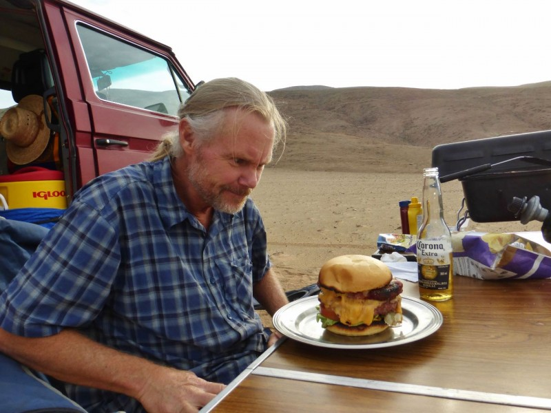 "I got out of bed long enough to munch down a burger patty while Ned attacked his masterpiece.  He then took an exhilarating hike to work it off.  Climbing to the top of a giant dune, he got to run back down the sandy slope barefoot like a little kid.  I crawled back to bed in Charlotte, green with envy.  Ned returned just before dark, exclaiming, ""I feel alive!""  Yes, definitely jealous."