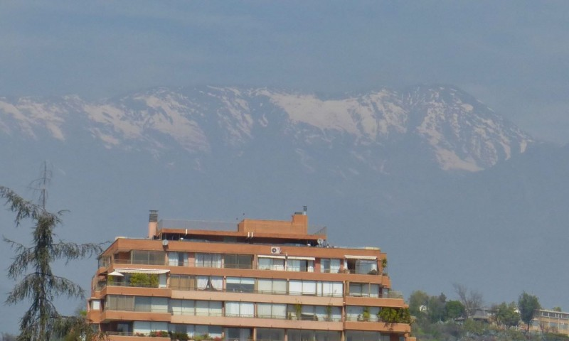 "On September 20, we cruised right in to Santiago. Surprisingly, there was no traffic and no navigation fights. The only bad thing was the horrendous smog.  Santiago is in a gorgeous setting surrounded by snow capped mountains but you can't see them!   We drove right to Hotel Acacias de Vitacura, and were instantly charmed.  Sebastian had made the reservation for us and it was perfect – a balcony overlooking a lush garden, a fridge, and HEAT again for the first time in the whole trip.  The room was done all in white with a white carpet and we cringed knowing we (dirt bags) would trash it!  I had finished my last course of antibiotics two days before and was already struggling with another relapse.  I pulled out a business card José (from Basecamp) had given me and began to experience the true kindness of Santiagans.  José's brother was a doctor at the Clinica Las Condes, the very hospital I had found on Google, and José had given me his cell phone number.  I hesitated to call on a Saturday night, but I was beginning to feel desperate.   Dr. Bravo could not have been nicer.  Far from being annoyed by my call, he was expecting it.  José had filled him in previously, and he was ready to set me up with a specialist.  I was to call him back on Monday morning at 8:00am.  I was close to a melt down at this point, but had high hopes of the specialist being able to cure me.   By Monday I was feeling even worse, but Dr. Bravo came through.  In spite of it being the Monday after a long holiday week, he was able to get me in to an Infectious Disease doctor at 1:00pm.  Ned had arranged to work on Charlotte's roof rack and replace the worn out upper A-arm bushings and upper ball joints at a friend of Sebastian's, so I took a taxi to the clinic (which was serendipitously only a mile away).   I waited less than five minutes to see the doctor, who came to greet me personally.  Dr. Blamey then proceeded to listen, in detail, to all that had happened since the illness began in August.  He also asked pertinent questions, gave me an exam and patiently spent an entire hour with me.  In the end, he said I still had a raging sinus infection and prescribed another antibiotic, a steroid nasal spray and an expectorant.  As I departed, Dr. Blamey gave me a big, warm hug. Interestingly, when I arrived at the clinic, I had noticed a lot of hugging going on between doctors and staff and I experienced a moment of uneasiness at first.  After all, here in the United States, we are well tuned in to the potential pitfalls of sexual harassment.  But here in Santiago, Chile I found it heartwarming, and my hug from Dr. Blamey was a welcomed comfort. Dr. Blamey had also set me up to see an ear, nose throat doctor who was equally as patient and kind.  Unfortunately, he said I was battling allergies as well and prescribed four more drugs, on top of the three I was already on, one of which was oral steroids.   I have for years, chosen alternative, natural medicine over traditional pharmaceutical medicine, even for Lyme disease, and the thought of taking seven drugs was horrifying.  Ned and I had a long hard discussion, weighing the option of ""drugging up"" and continuing on or flying home.  It was a hard decision, but once made it, home sounded like paradise.  We booked our flights and flew home the next day."