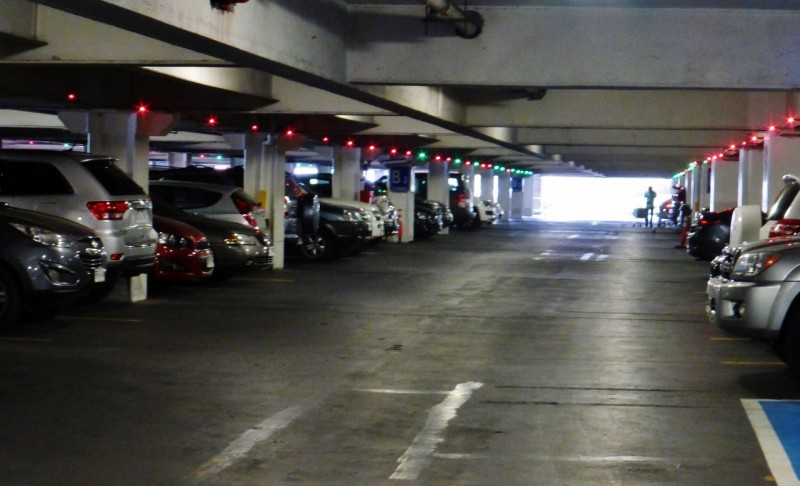 We discovered a big indoor mall near our hotel and spent a couple of hours enjoying modern comforts and escaping Santiago's damp, smoggy air.  We were even entertained by the parking garage (have we been in the sticks too long?).  The red lights indicate that the stall is occupied, while the green says it is available so you don't have to drive up and down the aisles looking for a spot.  Wow, who thought of that?