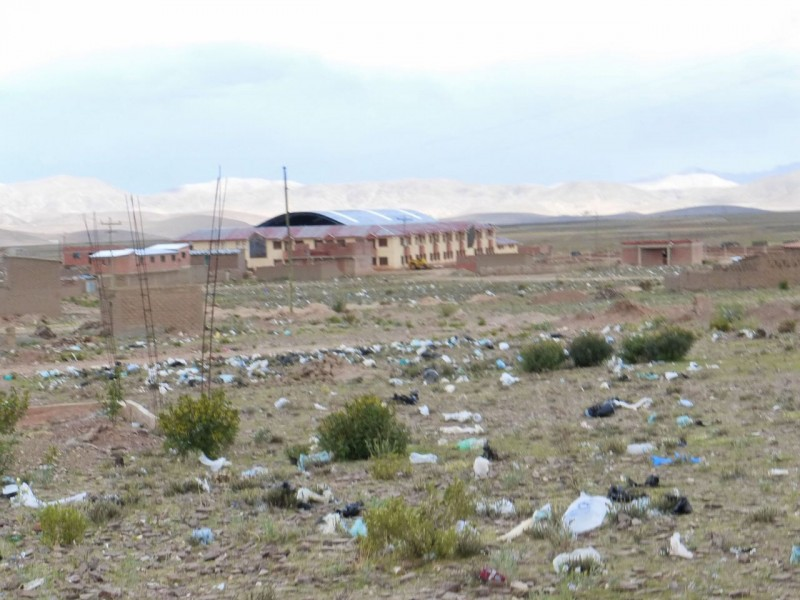 After a couple of hours of driving and seeing no towns we took a side road around the grimy mining town of Potosí, which took us to the even grimier village of Belén.  Approaching the town revealed the persistent problem of plastic trash in countries with no garbage collection programs.