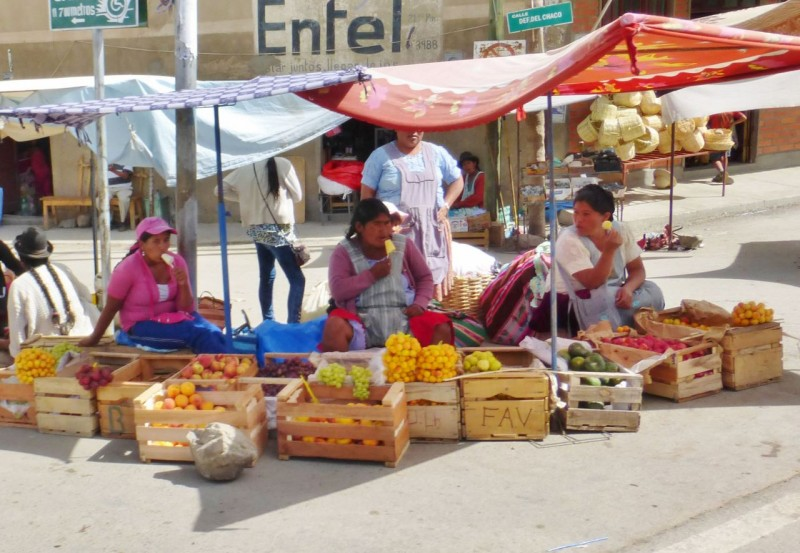 These gals had it a little more together with a clean street to sell their fresh fruit on and ice cream to go around!