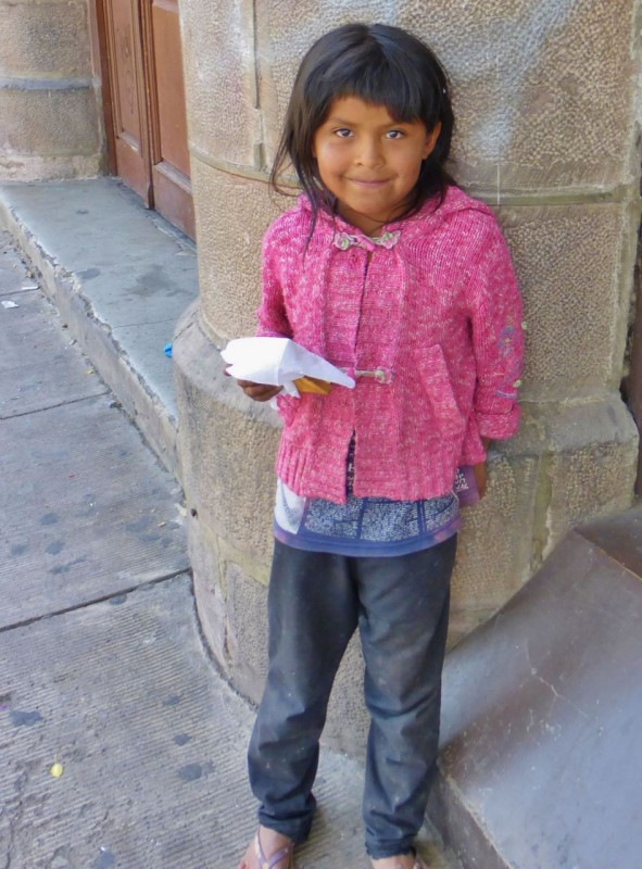 We gave this little street beggar toast with jam and butter in exchange for a big smile.  Wonder where she spent her Christmas?