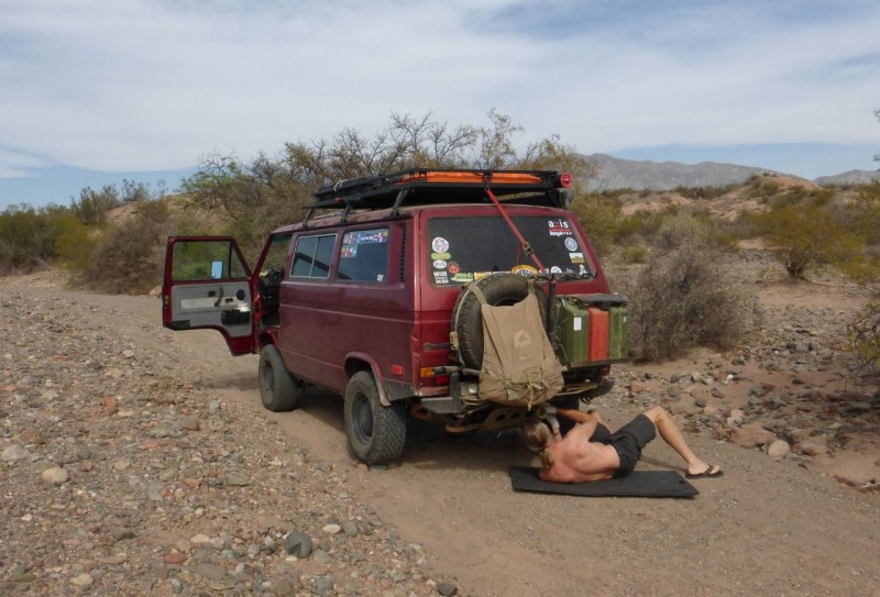 Our experience of Mendoza was of an ugly, grimy city.  Perhaps we were tired, hot and crabby and only saw the bad side.  We got some crummy food at a grimy grocery store, had a good navigation fight, and got out of there. We found this out-of-the-way wash on a dirt road off of Ruta 40, had some beer and cheese for dinner and camped for the night.   In the morning Ned decided to remove the skid plate which had been encrusted with fluid/oil leaks and road dirt to the point where it was going to rub a hole in the bottom of the transmission if something wasn't done about it.