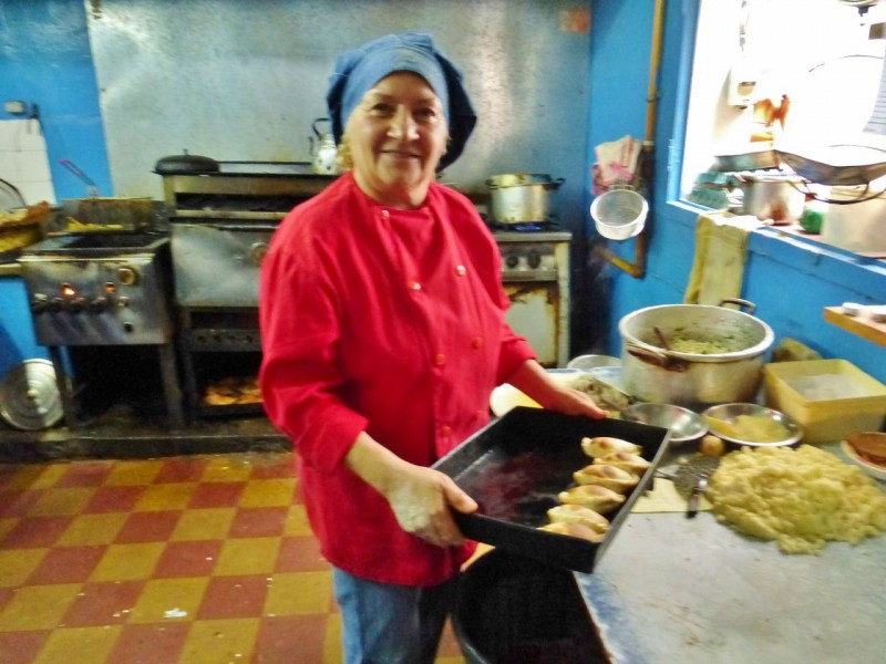 Our favorite breakfast spot quickly became Alicia's which we visited twice.  Isabel was the head honcho in the kitchen and insisted she put on a clean red chief's jacket before I took her fuzzy picture.  Here she displays freshly made empanadas, minced meat and vegetables wrapped in a pastry crust – delicious!