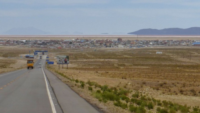 Dropping down into the town of Uyuni, Bolivia on the edge of the Salar de Uyuni, the endless salt flats seen in the distance.
