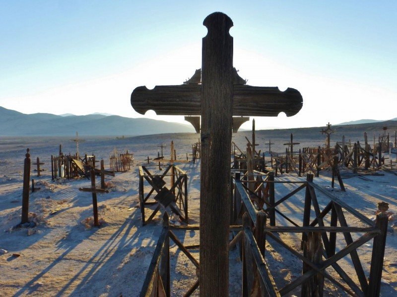 The ornate designs of some of the crosses made eerie statements in the waning light.
