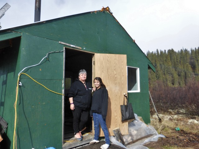 "Art's not-wife Yvonne and Muffy, their not-daughter, whom they have raised since she was two, standing in the doorway of Art's summer hunting cabin. We were getting a crash course in Canadian First Nation family life! Art and Yvonne have been together 14 years but don't live together. They are from two different tribes. Art is Kaska and Yvonne is Tahltan. Muffy, or Yahlayla (her tribal name) is Yvonne's daughter's daughter but her grandmother (Yvonne) and her boyfriend (Art) have raised her. Got all that? It all didn't matter. They were the kindest, nicest, happiest folks you could ever meet and referred to themselves as ""Caninguns!"""