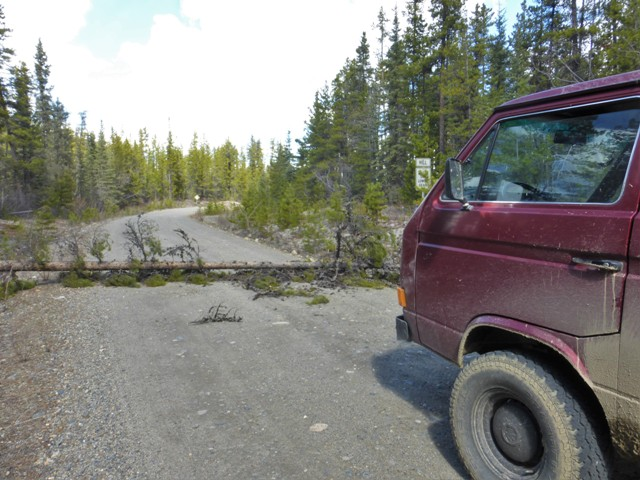 For the first 60 miles or so we saw tracks from other vehicles proving we were not the only ones ignoring the road closed sign. However once we reached Quiet Lake all the vehicle tracks ended and there were signs the final ones turned around. We motored on until we reached this downed tree, a sure sign that no one had been through the road since the previous fall.