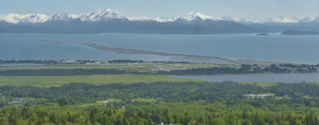 Homer sits on the Kachemak Bay in the Cook Inlet and is famous for the Homer Spit, as seen in the photo above. The spit is naturally formed, but strong, human made sea walls have preserved it from eroding to oblivion.